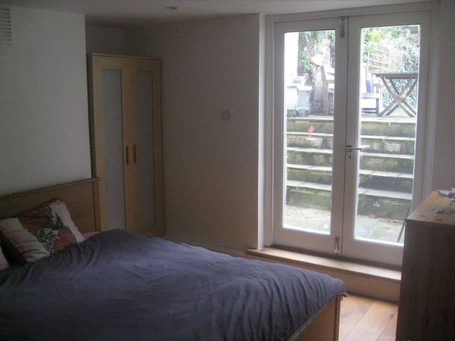 Cosy bedroom with direct access to the large garden.