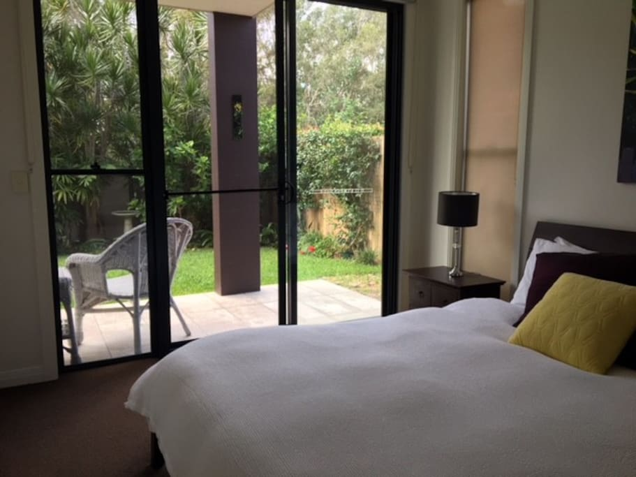 Queen size room with private patio and courtyard access