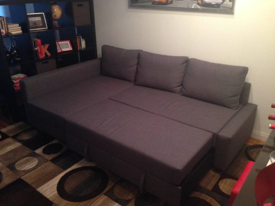 Sofa with chaise lounge that converts into queen size sleeper