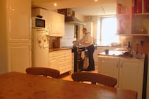 Open plan kitchen, dinning room and sitting room.