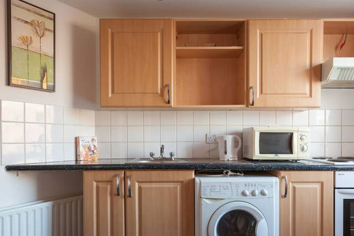 Fully equipped kitchen,  modern.  This apartment is not on the large size but is well equipped with everything you need.