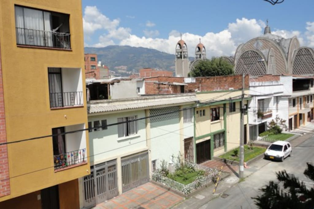 View from window. Note the mountains and church. What a beautiful day in Medellín.