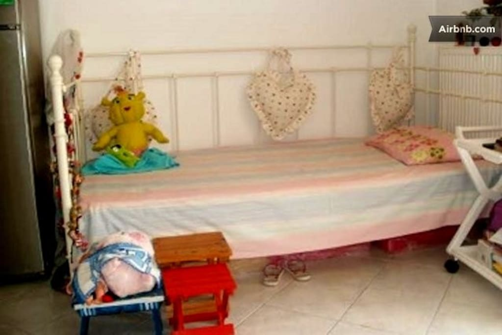 the same single bed in the kitchen used as a kid's bed