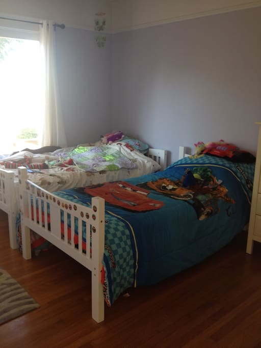 Kids room with two twin beds.