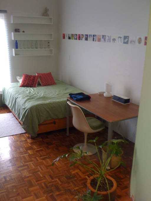 Main living, sleeping and working area with a full size bed