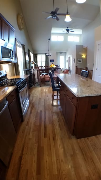 Hardwood floors, granite, high ceilings, fans.
