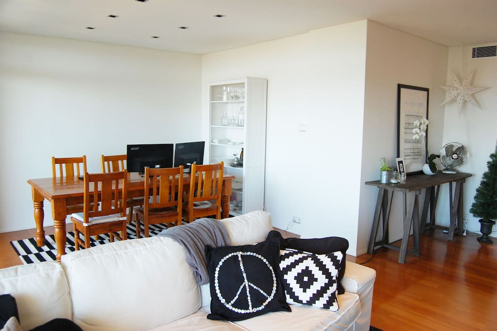 Huge bright living room with separate dining area, wall to ceiling windows with spectacular views over Bondi beach, 55 inch flat screen TV.