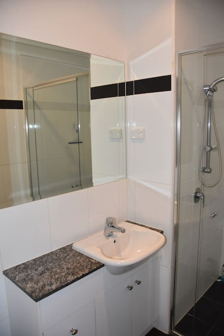 Private bathroom with shower, toilet & basin