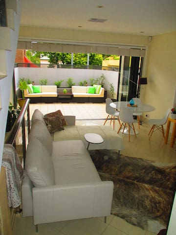Living, dining and courtyard.