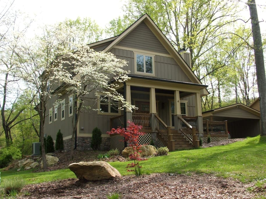 Dogwoods in bloom!  Front of the house...carport on the right has lots of storage space.