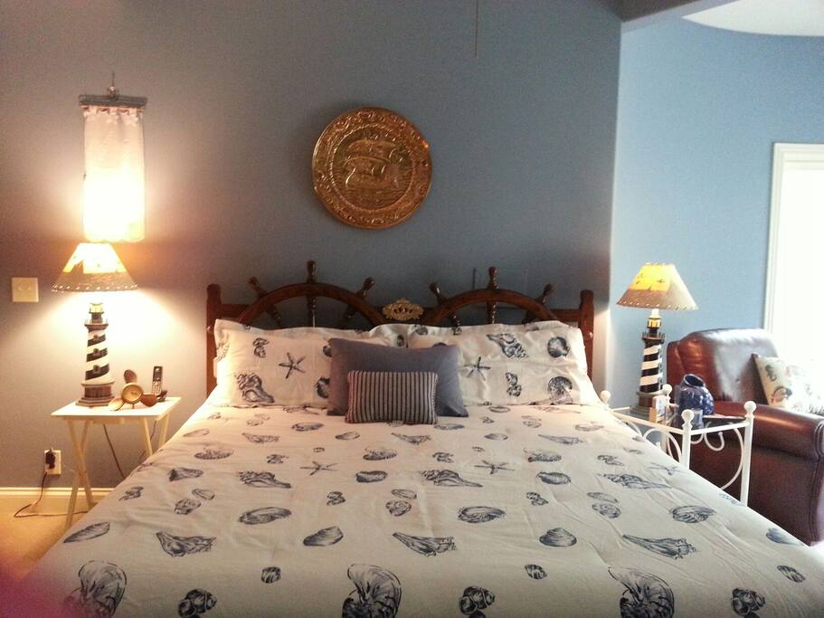 Very large nautical themed bedroom with a king-size bed.