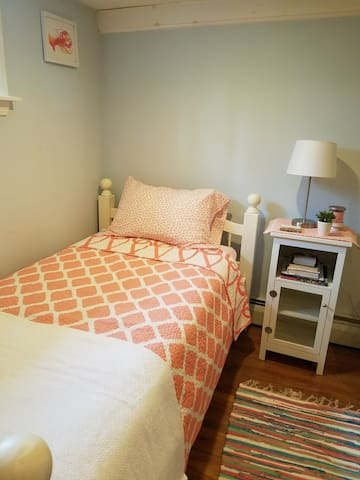 Second twin bed in bedroom