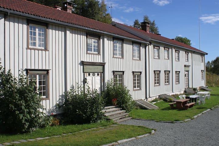 Storbuan Gård.  Farmhouse by a quite lake.