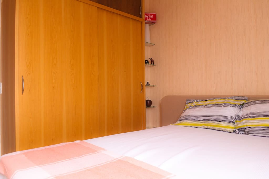 Nice double bed, TV on the bedroom, very confortable with a full closet to your stuff!