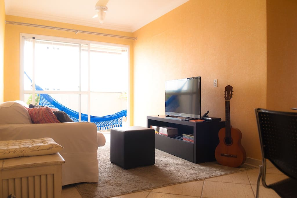 Living room, with a acoustic guitar not played in some years... you can try as you like...