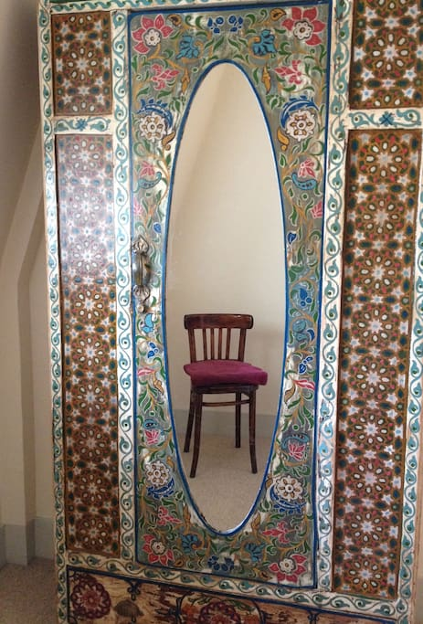 The room features some quirky details, including an antique Moroccan wardrobe.
