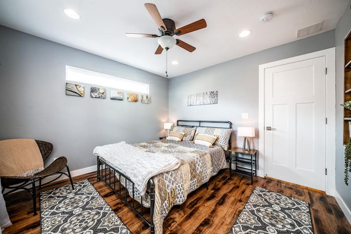 Aspen themed bedroom with queen size bed and workspace