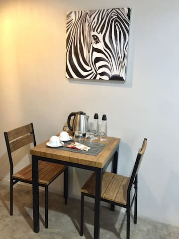 Table for 2 with water boiler , complimentary water and coffee