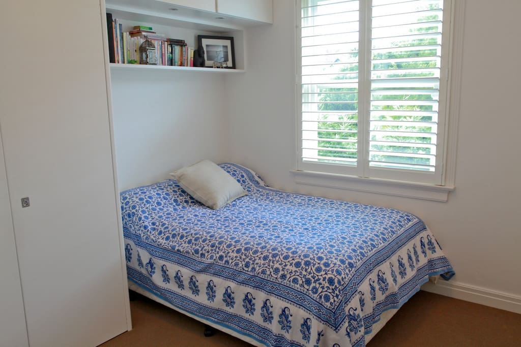 Bedroom is bright and airy with new queen bed