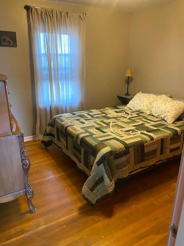 Queen sized Tempurpedic mattress in the bedroom.