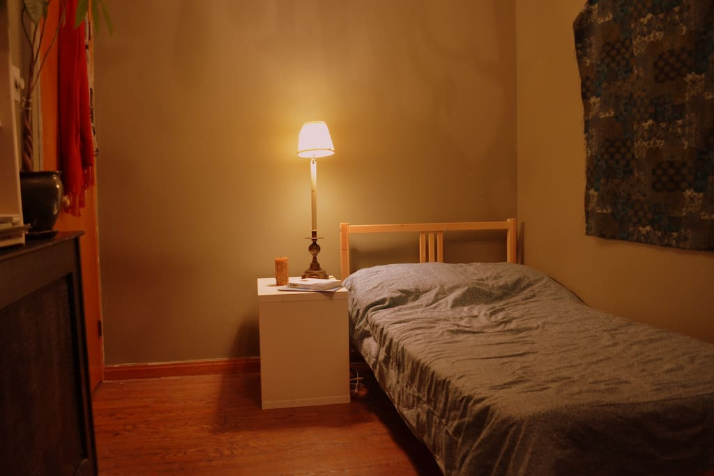 Twin bed with bedside lamp