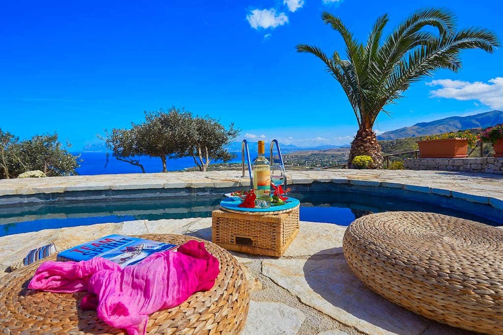 Sip a glass of Wine by the pool with great View