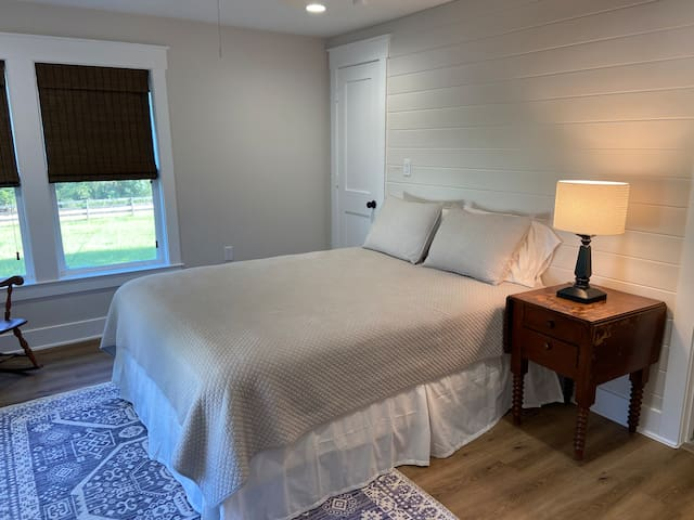 Primary bedroom with private bath. Room has a queen bed.