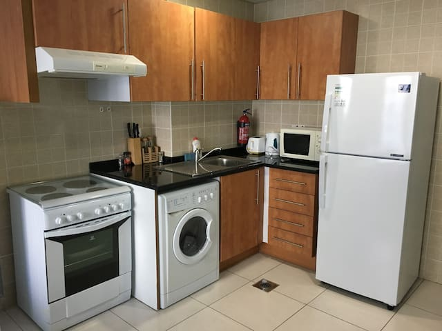 Full equipped kitchen with washing machine