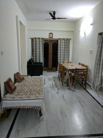 Entrance to Living room with sofa and TV