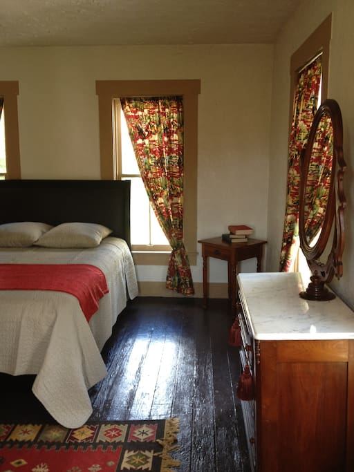Enjoy the quirky Cowboy Room furnished with antiques, Queen Bed, and vintage toys.