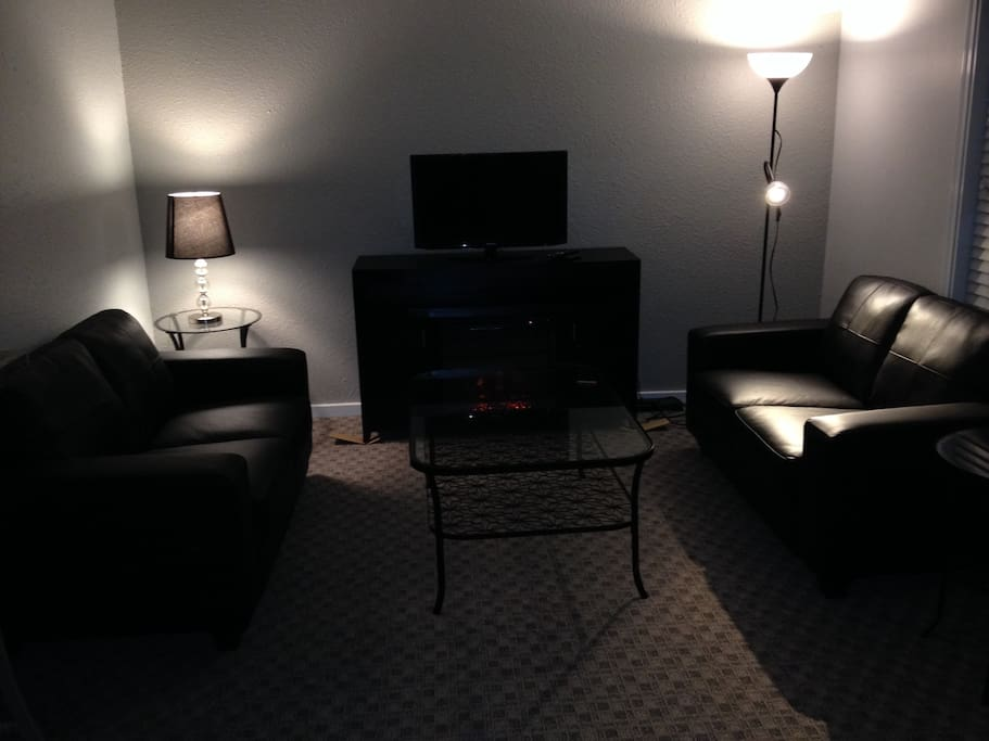 Cozy sitting area with wireless, TV and electric fire.