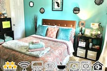 Pretty light and bright peacock themed room! This is the only bedroom downstairs and has a attached half bath. Mini fridge w/free waters, snacks/sodas for .50, guest only towels, fan, Wifi and full cable!  Free self serve breakfast with coffee/tea!
