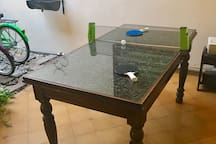 Not a perfect ping pong table, but it's pretty fun on a rainy afternoon! Ping pong set is included in living room cabinet with other games