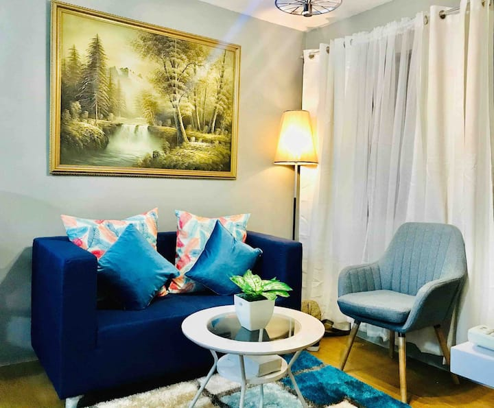 A charming and  cozy place near LRT Santolan Marcos Highway Pasig City,midrise resort type condominium with a 2 bedroom with a  complete amenities.