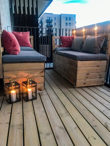 The balcony is a cozy place to relax in the evening