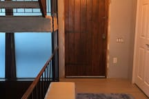Front door walk in area with bench to sit on to put your shoes on. Closet space available next to door for coats
