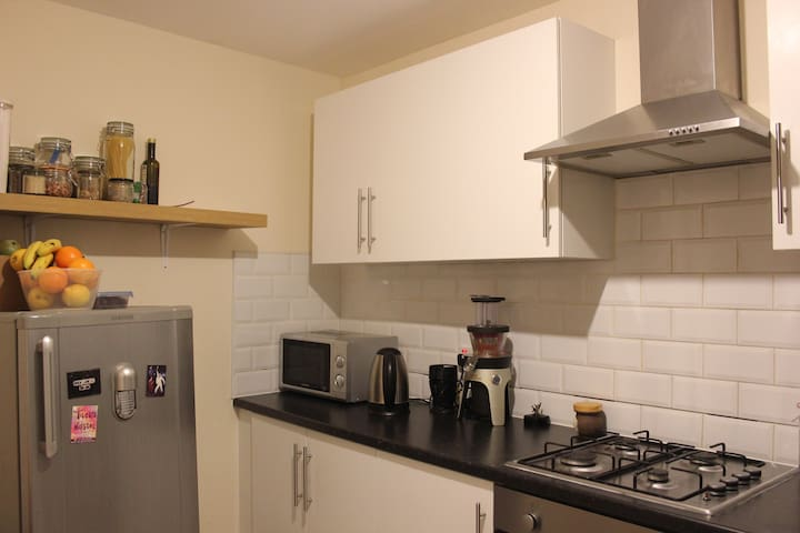 Kitchen with washing machine, microwave, kettle, blender and juicer for you to use - and help yourself to coffee and tea!