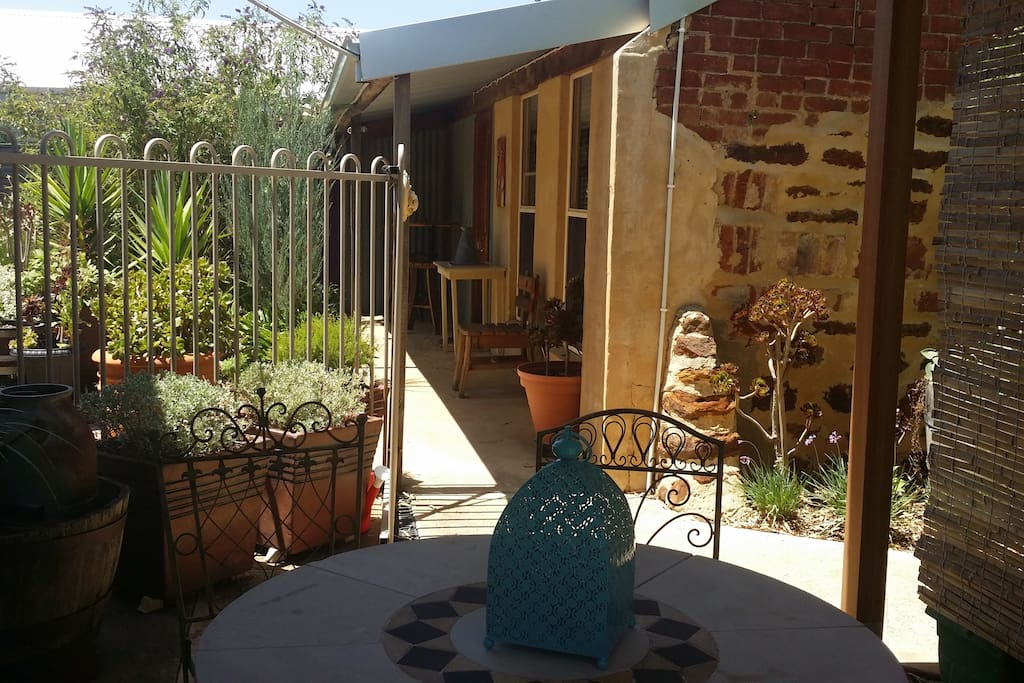 The property has a private, fenced garden