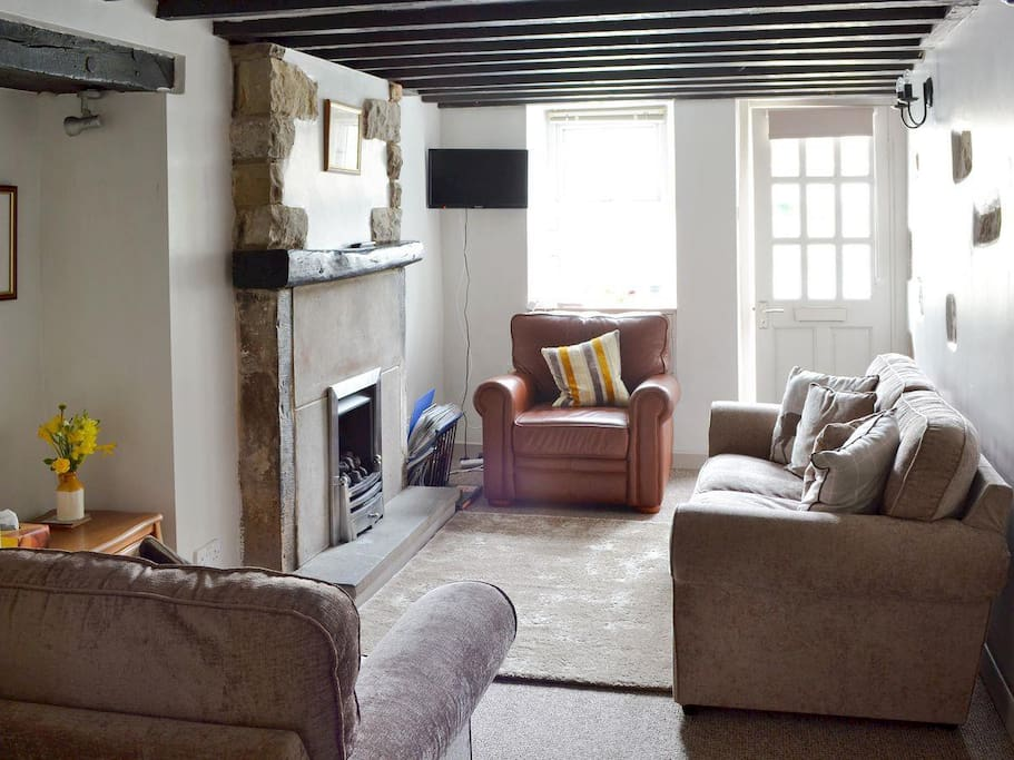 Restful cosy living room after a day walking with lovely feature fireplace and gas flame fire