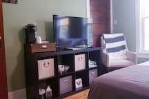 TV is connected to hulu and Netflix. Coffee maker and travel sized essentials are all located in the room
