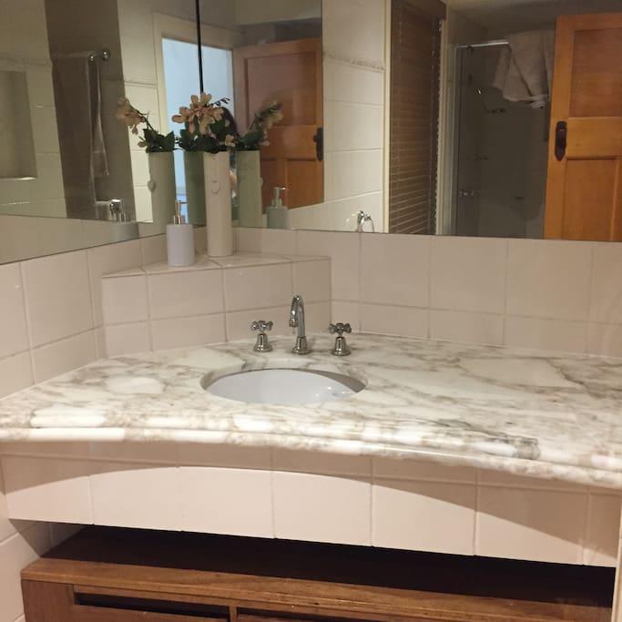 Bathroom with marble vanity.