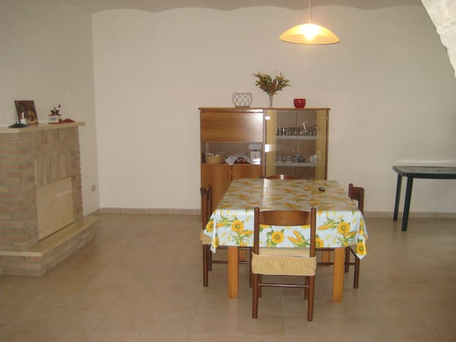 Large fully equipped kitchen with fireplace.