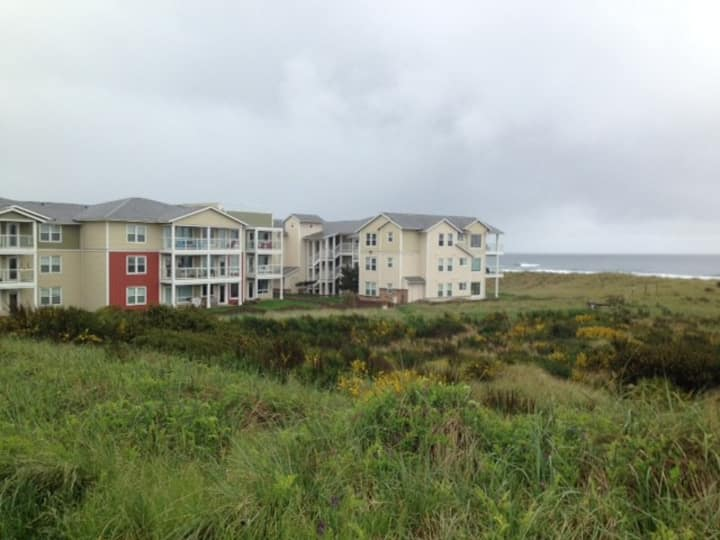 2B Beach condo with view steps from sand and waves