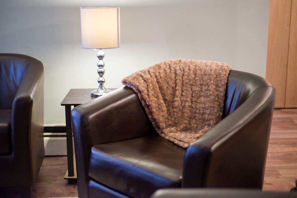 Small touches such as this blanket and pillows help this condo feel a little more like home.