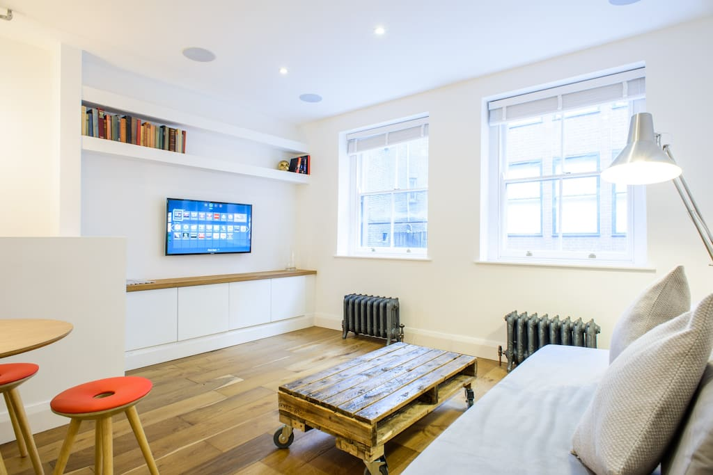 Brand new, interior designed luxurious flat - classic London cool meets modern tech apartment!