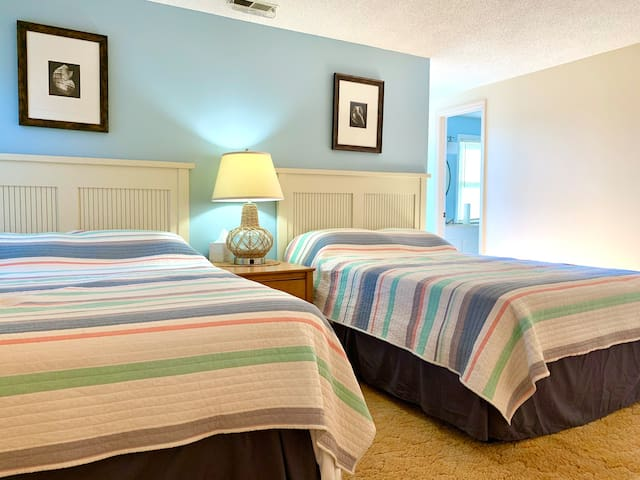 The upstairs double bedroom has two full beds, two closets and access to the Jack-and-Jill bathroom.