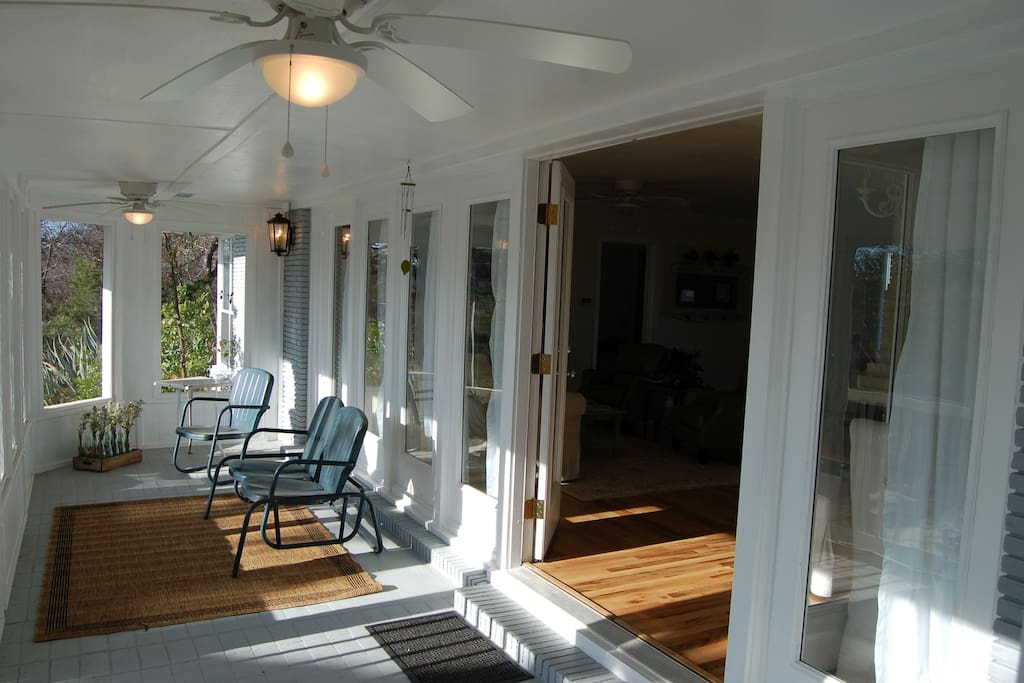 The screened-in back porch; perfect place for a good book or a cool drink - or both!