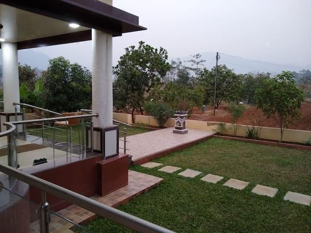 Regal Parsi  Bungalow amidst picturesque farms.