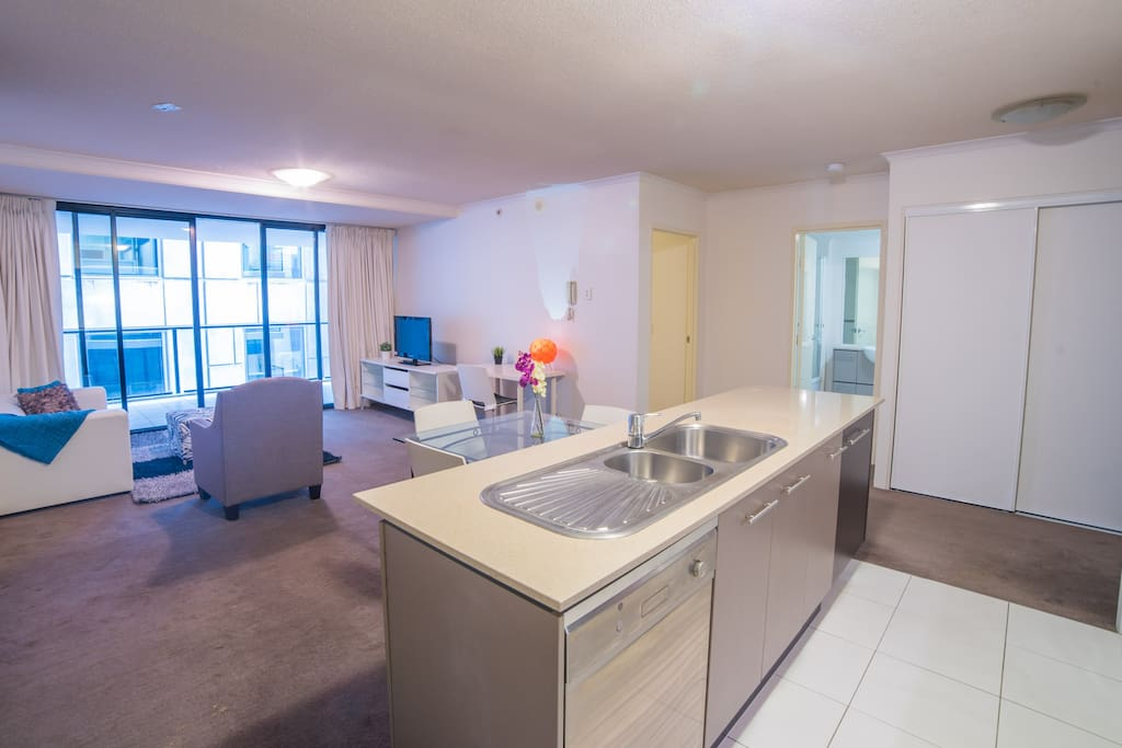 Beautiful open plan kitchen dining and lounge which flows onto balcony