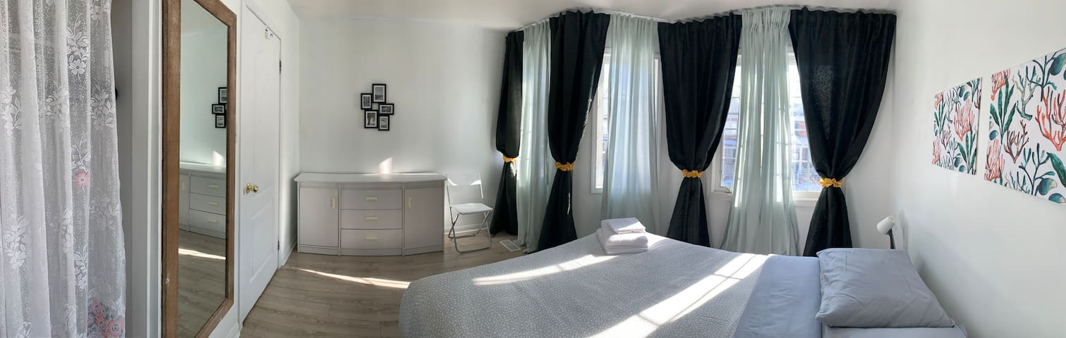 Queen Sized Bedroom with Shared Washroom